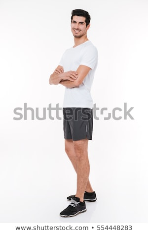 sports man standing with arms folded stock photo © deandrobot