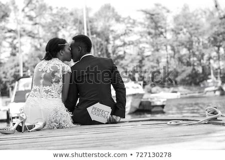 romantische · echtpaar · permanente · strand · zonsondergang · man - stockfoto © artfotodima