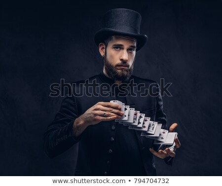 man magician showing tricks stock photo © deandrobot