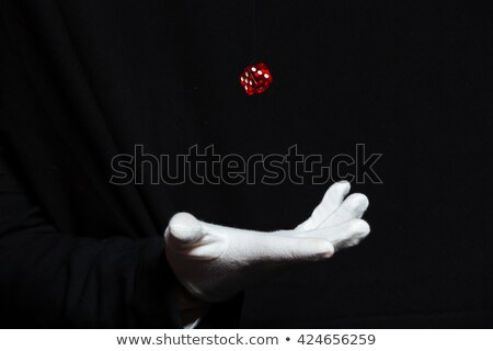 Hand of magician in white glove showing tricks with dice  Stock photo © deandrobot
