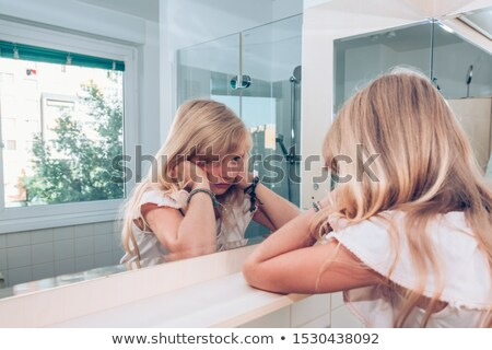 Adolescente regarder miroir belle portrait floue Photo stock © simply