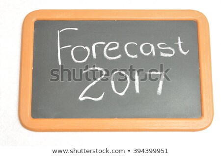 Text on blackboard with money - Forecast 2017 Stock photo © Zerbor