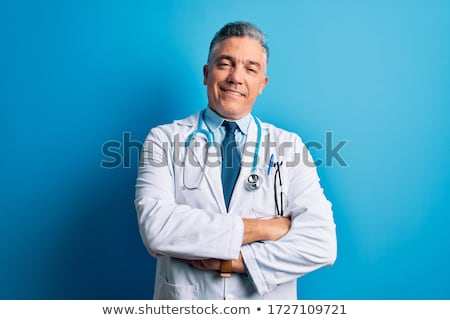 Stock photo: Senior doctor laughing to camera