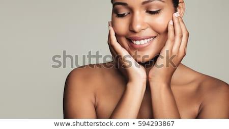 Piękna portret kobieta świeże skóry patrząc w dół Zdjęcia stock © deandrobot