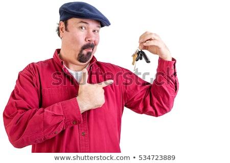 Dumny duży człowiek wskazując kluczyki cap Zdjęcia stock © ozgur