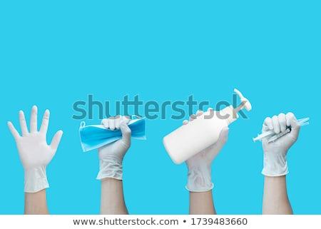 Mano guante jeringa aislado blanco Foto stock © Klinker