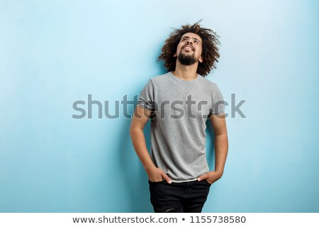 Homem enrolado mãos cabeça jovem Foto stock © nito