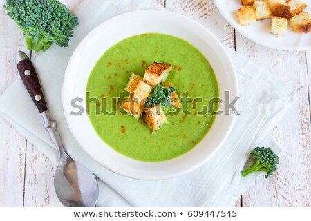 Homemade spicy broccoli cream soup with croutons in white bowl stock photo © FOTOART-MD