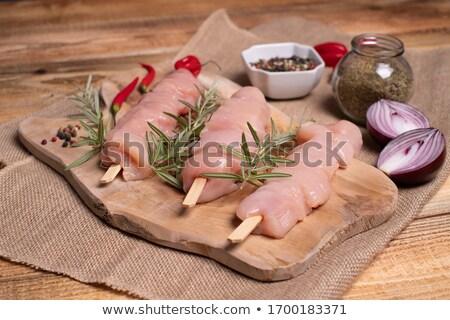 Brut poitrine de poulet filet bois planche à découper alimentaire Photo stock © Digifoodstock
