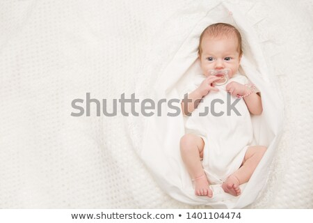 Baby lying indoors with soother Stock photo © monkey_business