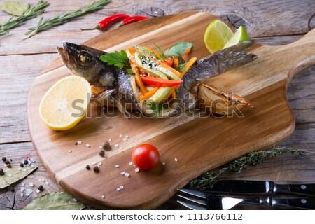 Peixe recheado legumes branco prato Foto stock © Yatsenko
