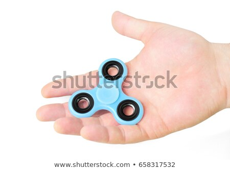 Male hand holding fidget spinner in palm, isolated on white Stock photo © elly_l
