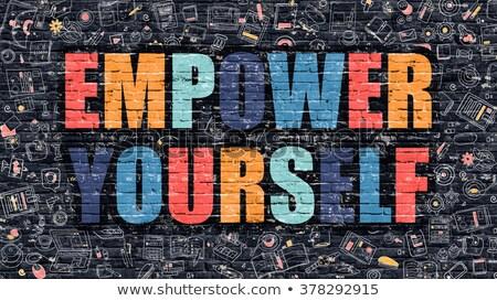 empower yourself in multicolor doodle design stock photo © tashatuvango