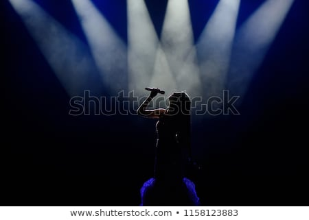 singer performing on stage stock photo © wavebreak_media