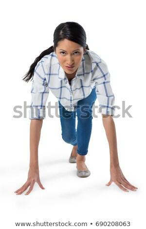Kobieta gotowy uruchomić biały portret telefonu Zdjęcia stock © wavebreak_media