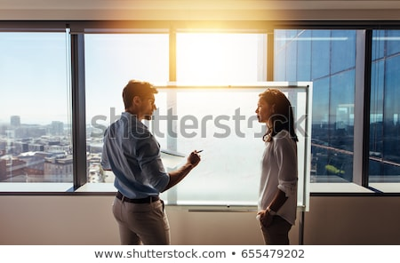üzletasszony magyaráz férfi kolléga ír ablak Stock fotó © wavebreak_media
