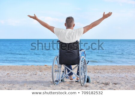 Back of disabled man in wheelchair at beach  Stock photo © manaemedia