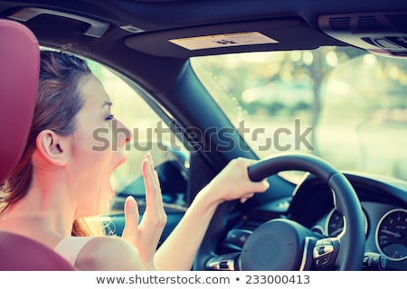 Sleepy woman driving her car after long hour trip isolated street background.  Stock photo © ichiosea