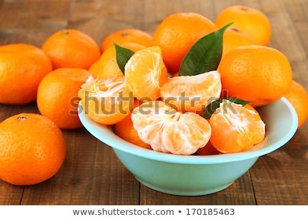 Tál érett mandarin narancsok levelek Stock fotó © Digifoodstock