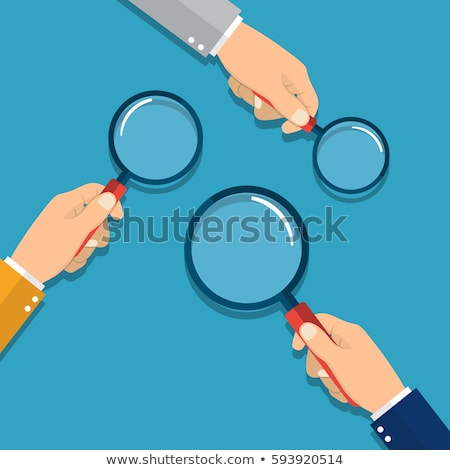 Businessman investigator looking with magnifying glass Stock photo © studiostoks