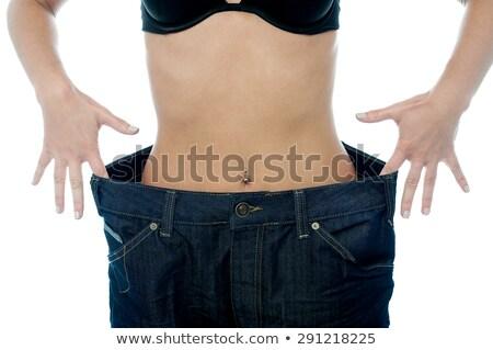 изображение бюстгальтер джинсов позируют кровать Сток-фото © deandrobot