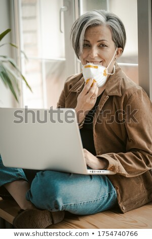 woman against window looking to camera stock photo © is2