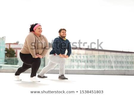 sports couple doing lunge stretch Stock photo © LightFieldStudios