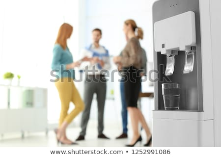 co workers by office water cooler stock photo © is2