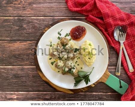 Meatballs in vegetable sauce with mashed potato, top view Stock photo © yelenayemchuk