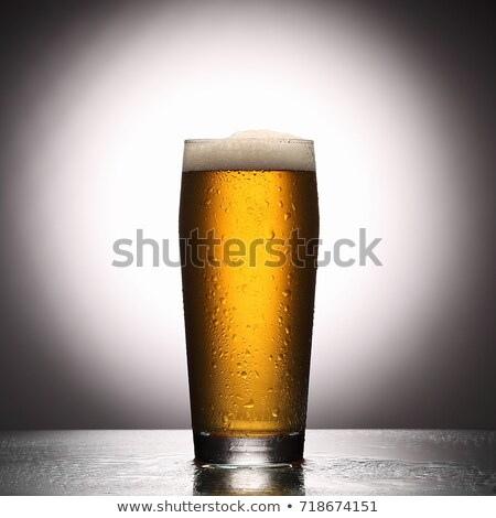 Fresh gold cold and delicious lager beer in glass over white background Stock photo © milsiart