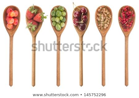 Rojo cuchara de madera aislado blanco saludable frutas Foto stock © serg64