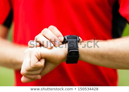 Runner looking at sport watch checking performance stock photo © blasbike