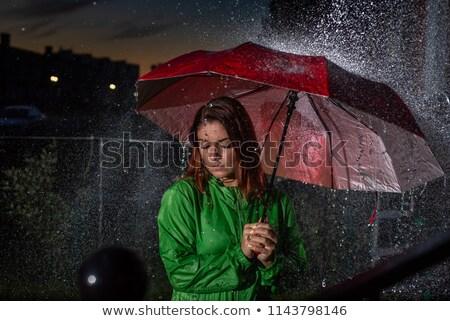 Stock photo: Female outdoors in rainy night