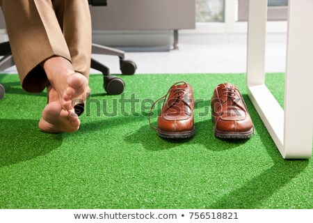 Relaxed feet on a green office carpet Stock photo © IS2