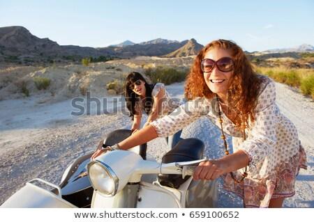 Kobiet popychanie motocykl drogowego krajobraz spaceru Zdjęcia stock © IS2