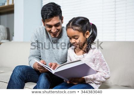 Apa lánygyermek olvas társalgó lány könyv Stock fotó © IS2