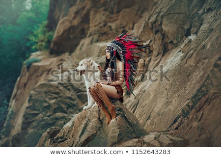 Girl with feather headdress Stock photo © IS2