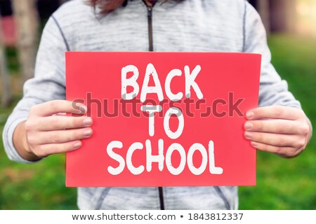 back to school message against green stock photo © wavebreak_media
