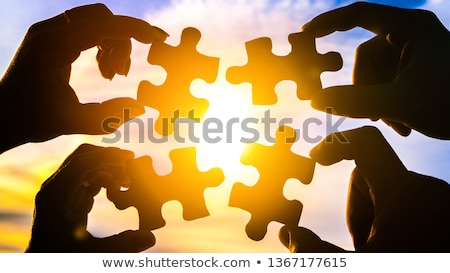 Person Holding Two Jigsaw Puzzle Stock photo © AndreyPopov