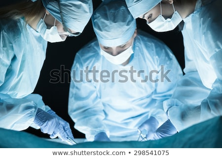 Three Surgeons Operating On A Patient Stock photo © monkey_business