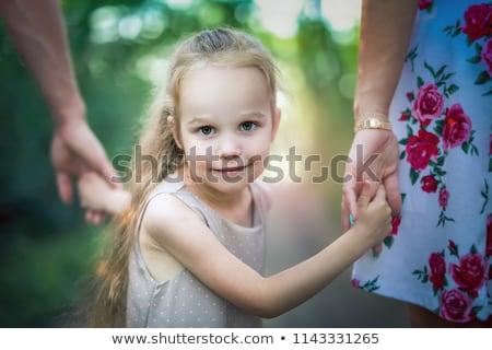 Filha mão idoso mãos Foto stock © AndreyPopov
