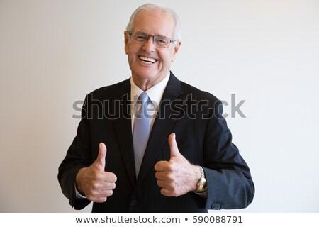ältere Geschäftsmann Lächeln Daumen up wie Stock foto © studiostoks