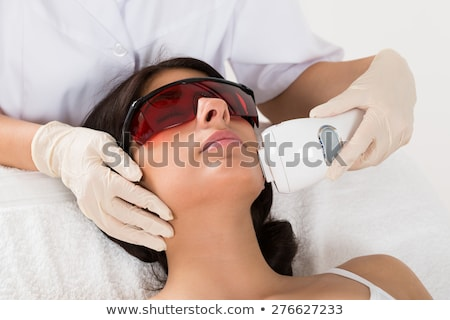 Beautician Giving Laser Depilation Treatment To Woman Face Stock photo © AndreyPopov