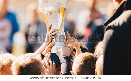 close up of kids sports team with trophy boys celebrating sport stock photo © matimix
