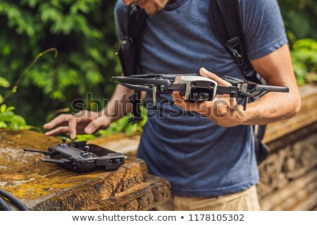 Stockfoto: Young Man Launches A Drone Into The Sky The Island Of Bali