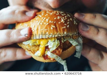человека гамбургер молодым человеком рубашку Сток-фото © studiolucky