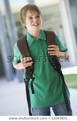Elementary school pupil outside carrying rucksack Stock photo © Lopolo