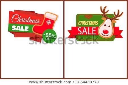 Christmas Sale Label Santa Socks, Gingerbread Deer Photo stock © robuart