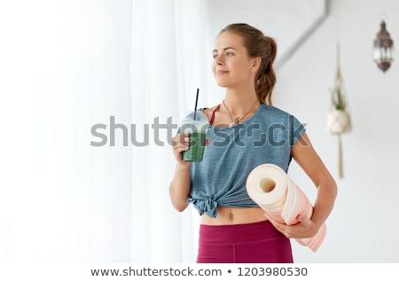 Kobieta kubek pochlebca jogi studio fitness Zdjęcia stock © dolgachov