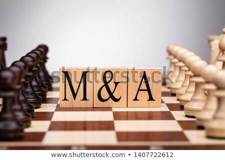 Pieces On Wooden Blocks With Mergers And Acquisitions Text Stock photo © AndreyPopov